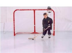 My young son on my backyard ice rink.