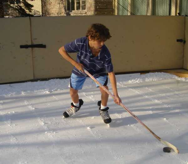 Playing with shorts on a refrigerated backyard hockey ice rink.