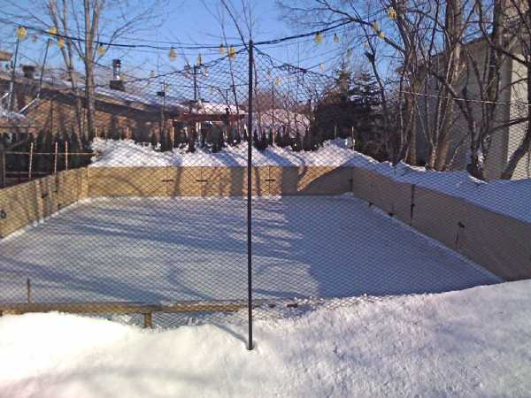 Backyard Ice Rink Installation : Here is a photo of my friends refrigerated backyard hockey rink