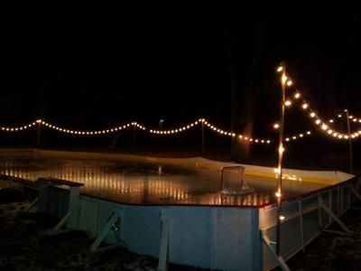 Backyard Ice Rink Lights central ohio rink on a sloped backyard.