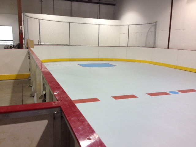 commercial synthetic ice rink and boards installation for hockey