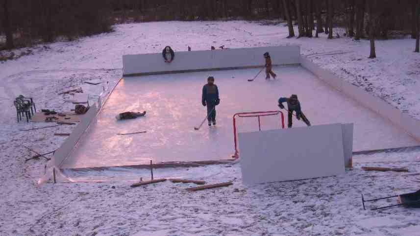 kids skating and falling on our backyard ice rink