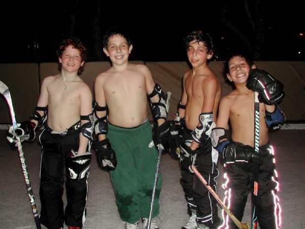 Naked backyard ice hockey