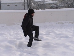 Stomping on snow to make ice on my backyard ice rink.