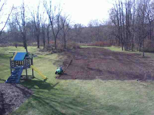 Leveling Backyard with Dozer for Backyard Rink