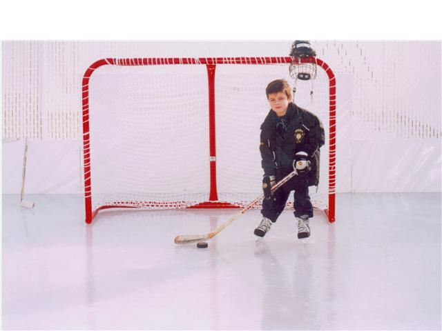 My young son on my first backyard ice rink.