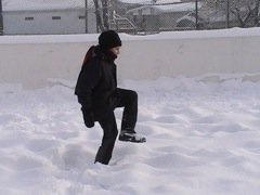 Stomping on Snow to Pack for Backyard Ice Rink