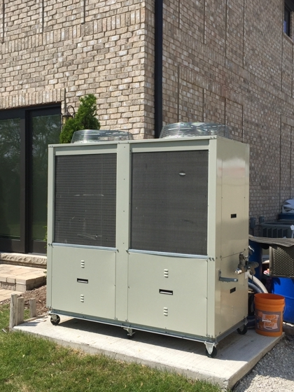 Back view of an ice rink chiller for a residential portable refrigerated outdoor ice hockey rink in Elmhurst, Illinois